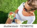woman eating healthy salad from ... | Shutterstock . vector #727085752