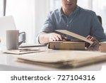 pleasant guy is laboring in... | Shutterstock . vector #727104316