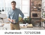 pleasant positive worker is... | Shutterstock . vector #727105288