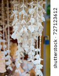 Small photo of Shell necklaces hanging for sale in Key West, USA on blurred background. Jewelry and adornment. Souvenirs, gifts and presents. Summer vacation and holiday. Travel and traveling concept