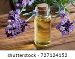 a bottle of lavender essential... | Shutterstock . vector #727124152