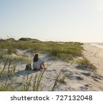 Seated Woman In Pristine Sand...