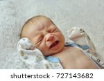 newborn baby crying and laying... | Shutterstock . vector #727143682