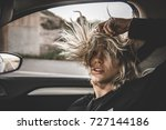young blonde woman inside a car ... | Shutterstock . vector #727144186