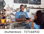 smiling young african barista...   Shutterstock . vector #727166932