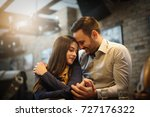 couple in love with a cafe. | Shutterstock . vector #727176322