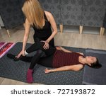 young female masseur performs... | Shutterstock . vector #727193872