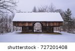 A Historic Barn In The Snow At...