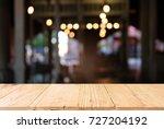 empty dark wooden table in... | Shutterstock . vector #727204192