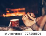 bare woman feet by the cozy... | Shutterstock . vector #727208806