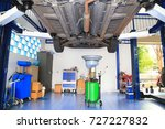 car service. lift the car to... | Shutterstock . vector #727227832