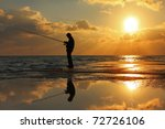 Fisherman Standing On A Pier At ...