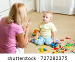 mother scolding her little kid... | Shutterstock . vector #727282375