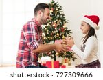 father and daughter exchanging... | Shutterstock . vector #727309666
