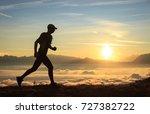 athlete trailrunning in the... | Shutterstock . vector #727382722