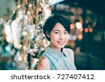 portrait of asian woman in cafe ... | Shutterstock . vector #727407412