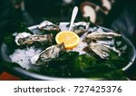fresh tasty oysters with a... | Shutterstock . vector #727425376