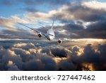 passenger jet plane in the sky. ... | Shutterstock . vector #727447462