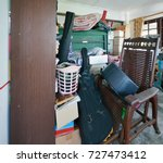messy storage room in garage... | Shutterstock . vector #727473412