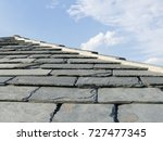 a slate tiled roof. on a...   Shutterstock . vector #727477345
