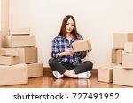 young woman with cardboard box... | Shutterstock . vector #727491952
