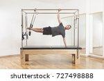 pilates instructor performing... | Shutterstock . vector #727498888