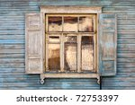 Old Window On A Blue Wooden Wall