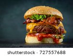 burger on a dark background | Shutterstock . vector #727557688