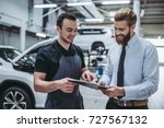 handsome businessman and auto... | Shutterstock . vector #727567132