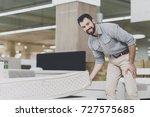 a man in a gray shirt and white ... | Shutterstock . vector #727575685