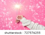 sparkling bengal fire in a... | Shutterstock . vector #727576255