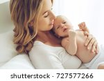 woman and child | Shutterstock . vector #727577266