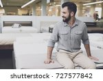 a man in a gray shirt and white ... | Shutterstock . vector #727577842