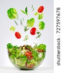 salad falling in a bowl | Shutterstock . vector #727597678