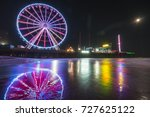 steel pier with reflection at... | Shutterstock . vector #727625122
