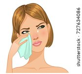 young woman cries and wipes... | Shutterstock .eps vector #727634086