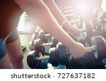 sport girl holding weight on... | Shutterstock . vector #727637182