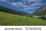 Small photo of View of green meadows and afforested mountains towards south of Predazzo village on a bright sunny morning, Latemar, Dolomites, Trento, Trentino, Alto Adige, South Tyrol, Italy