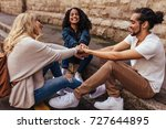 young people sitting together... | Shutterstock . vector #727644895
