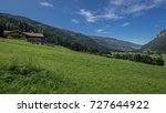 Small photo of View of green meadows and afforested mountains towards south of Predazzo village as seen from a dirt road outside the village, Latemar, Dolomites, Trento, Trentino, Alto Adige, South Tyrol, Italy