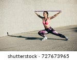 strong young woman stretching... | Shutterstock . vector #727673965