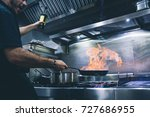 chef cook with frying pan | Shutterstock . vector #727686955