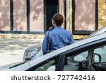 Small photo of NYPD Woman officer issuing summons to an illegally parked car