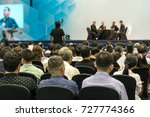 Small photo of Speakers on the stage with Rear view of Audience in the conference hall or seminar meeting, business and education about investment concept