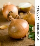 Head of  onion on a wood background. - stock photo