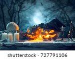 halloween pumpkins on blue... | Shutterstock . vector #727791106