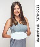 smiling woman holding white... | Shutterstock . vector #727840216