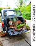 english taxi used as a planter | Shutterstock . vector #727863568