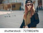 pretty girl in the summer city... | Shutterstock . vector #727882696