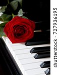 red rose on piano   | Shutterstock . vector #727936195